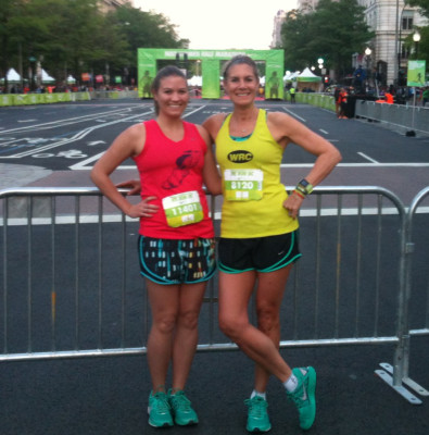 Carla Freyvogel poses with her daughter, Grace Eginton, in their respective club singlets and matching teal sneakers, in front to the NWHM Start/Finish line, at 10th and Pennsylvania Ave, NW. Photo courtesy of W.T.F.