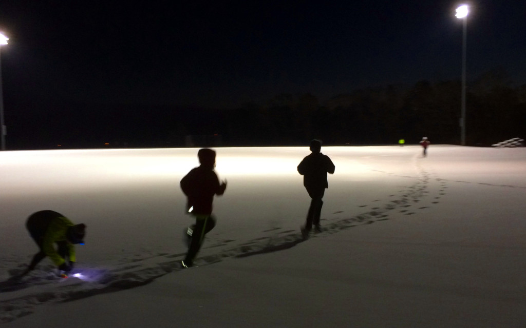 Ten little kids run laps in six inches of snow and 15°F, 5:30 PM on Wednesday, January 29th, under the lights at the Falmouth High School Track. Photo by Ken Gartner