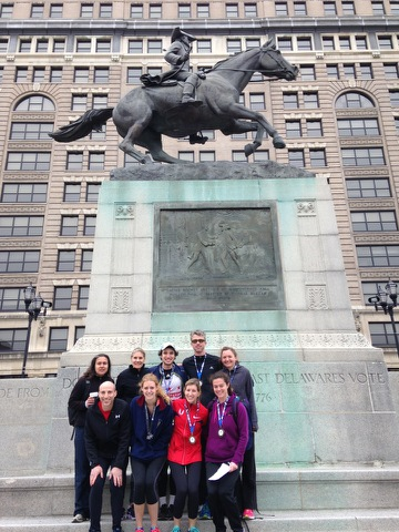 Nine decorated WRCers, standing in front of the equestrian statue of Caesar Rodney at Rodney Square in Wilmington, DE. Like our runners, the horse is depicted in full gallop.